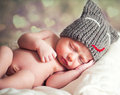 Newborn baby in the cap bear sleeps Royalty Free Stock Images