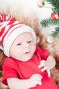 Newborn baby in chritstmas hat Royalty Free Stock Photos