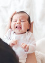Newborn baby crying in the arms of her mother. Royalty Free Stock Photo