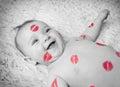 Newborn baby gir filled kisses Royalty Free Stock Photo