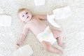 Newborn baby girl with diapers. Dry skin and nursery Royalty Free Stock Photo