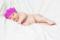 Newborn baby girl in a princess pink crown Royalty Free Stock Photo