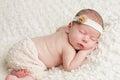 Newborn baby girl in skirt and headband