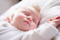 Newborn baby girl sleeping in bed close up of Royalty Free Stock Photography