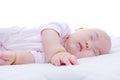 Newborn baby girl sleeping in bed Royalty Free Stock Photo