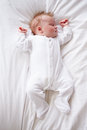 Newborn baby girl sleeping in bed on her own Royalty Free Stock Photography