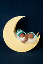 Newborn Baby Girl Sleeping on the Moon Royalty Free Stock Photo