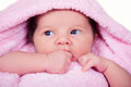 Newborn baby girl on a soft pink terry towel Royalty Free Stock Photo