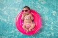 Newborn Baby Girl Wearing a Bikini and Sunglasses Royalty Free Stock Photo