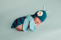 Newborn baby girl wearing a dragonfly costume portrait of sleeping week old turquoise blue crocheted Stock Photos