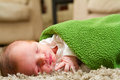 Newborn Baby in Green Blanket Stock Images