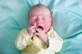 Newborn baby on a green blanket Royalty Free Stock Photo
