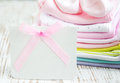 Newborn baby greeting pink apparel with blank card Royalty Free Stock Photography