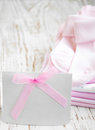 Newborn baby greeting pink apparel with blank card Royalty Free Stock Images