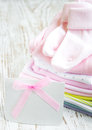 Newborn baby greeting pink apparel with blank card Royalty Free Stock Photos