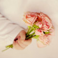 Newborn baby hand holding bouquet Royalty Free Stock Photo