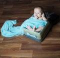 Newborn baby inside basket Royalty Free Stock Photo