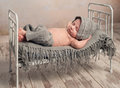 Newborn baby in knitted hat and pants sleeping Royalty Free Stock Photo