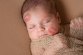 Newborn Baby with Lipstick Kisses on Face Royalty Free Stock Photo