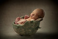 Newborn baby in military helmet a sleeps tucked inside his father s army Royalty Free Stock Photos