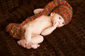 Newborn baby portrait in  woolen hat Stock Photography