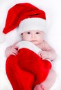 Newborn baby in a santa hat for christmas Royalty Free Stock Images