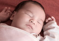 Newborn baby sleeping on the bed selective focus Royalty Free Stock Photography