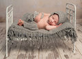 Newborn baby sleeping on old cot Royalty Free Stock Photo