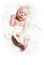 Newborn baby smiling boy on white bedding Stock Images