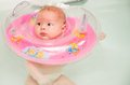 Newborn baby swimming in bath Stock Photo