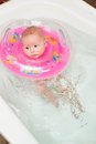 Newborn baby swimming  in a bathroom Royalty Free Stock Photos