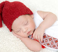 Newborn baby in ukrainian embroidery and red hat Royalty Free Stock Photo