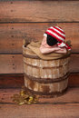 Newborn baby wearing a pirate hat and eye patch one week old boy crocheted red white black he is sleeping in rustic wooden Stock Images