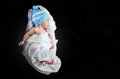 Newborn baby wearing white silk cocoon shape cloth Royalty Free Stock Photo
