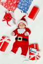 Newborn baby weraing Santa Claus costume Royalty Free Stock Images