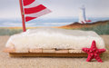 Newborn backdrop prop of a raft near the beach. Royalty Free Stock Photo