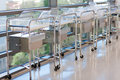 Newborn bassinets or beds in hospital hallway a row of isolettes of a maternity ward awaiting occupancy by infants are made of Royalty Free Stock Photos