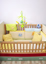 Newborn bed with musical toy Stock Image