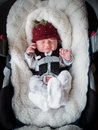 Newborn boy in car seat Stock Image