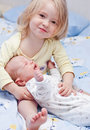Newborn brother and little sister at the hands of the Royalty Free Stock Photography