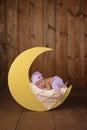 Newborn Girl Sleeping on the Moon Royalty Free Stock Photo
