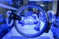 Newborn having a treatment for jaundice under ultraviolet light Royalty Free Stock Photo
