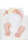 Newborn infant baby girl sleeping on her back o a white background Royalty Free Stock Photos