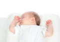 Newborn infant baby girl sleeping on her back a white background Royalty Free Stock Images