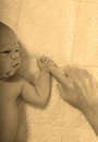Newborn infant holding mother s finger baby Stock Images