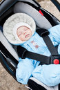 Newborn sleeping in the car seat boy outdoors Royalty Free Stock Photography