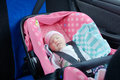 Newborn sleeping in car seat.Safety concept. Infant baby girl. secure driving with children. Baby care lifestyle Royalty Free Stock Photo