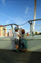 Newcastle two little boys looking at millennium bridge over river tyne in uk Stock Image