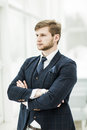 Newcomer businessman in a business suit stands near the window, Royalty Free Stock Photo