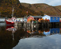 Newfoundland fishing boats and stages Royalty Free Stock Photo